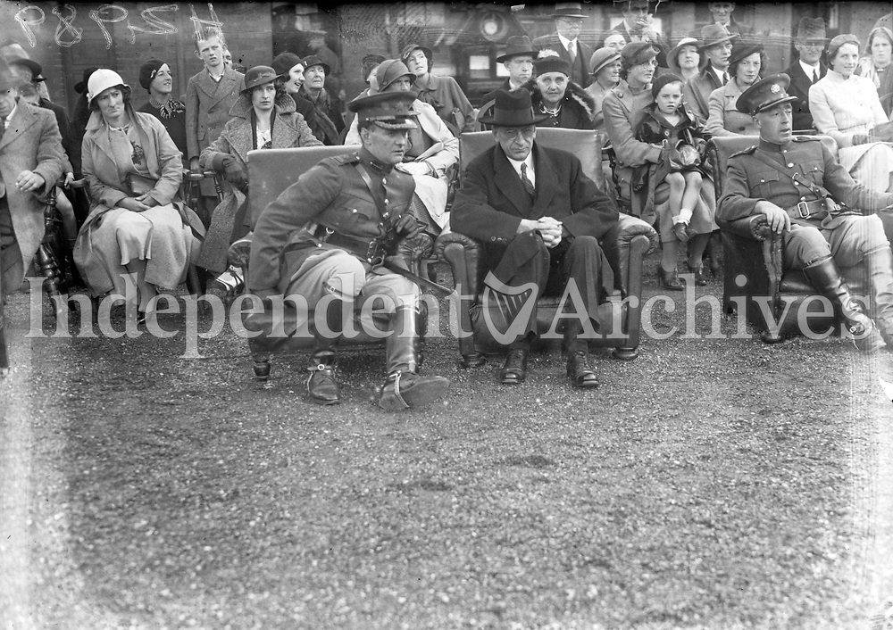 H2989 National Army - Commissioning of Volunteer Cadets. Mr Eamon De Valera seated. 1935. Seated to the left of Devalera is Lt-Gen Michael Brennan Chief of staff of the Irish Army (1931-1940). Michael was born and raised in Meelick Co-Clare and is buried in Glasnevin Cemetery co Dublin.(Part of the Independent Ireland Newspapers/NLI Collection)