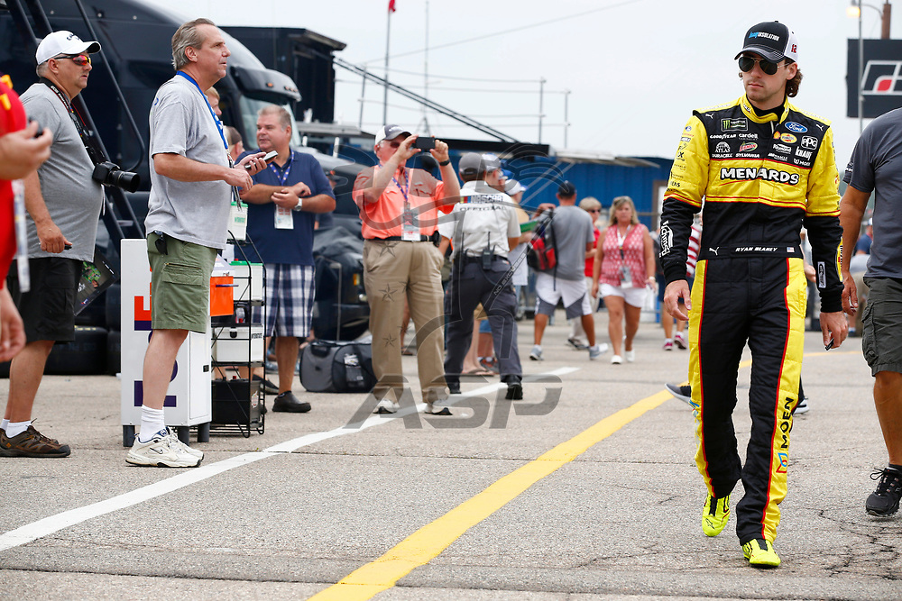 Ryan Blaney (12) hangs out in the garage during practice for the Consumers Energy 400 at Michigan International Speedway in Brooklyn, Michigan.