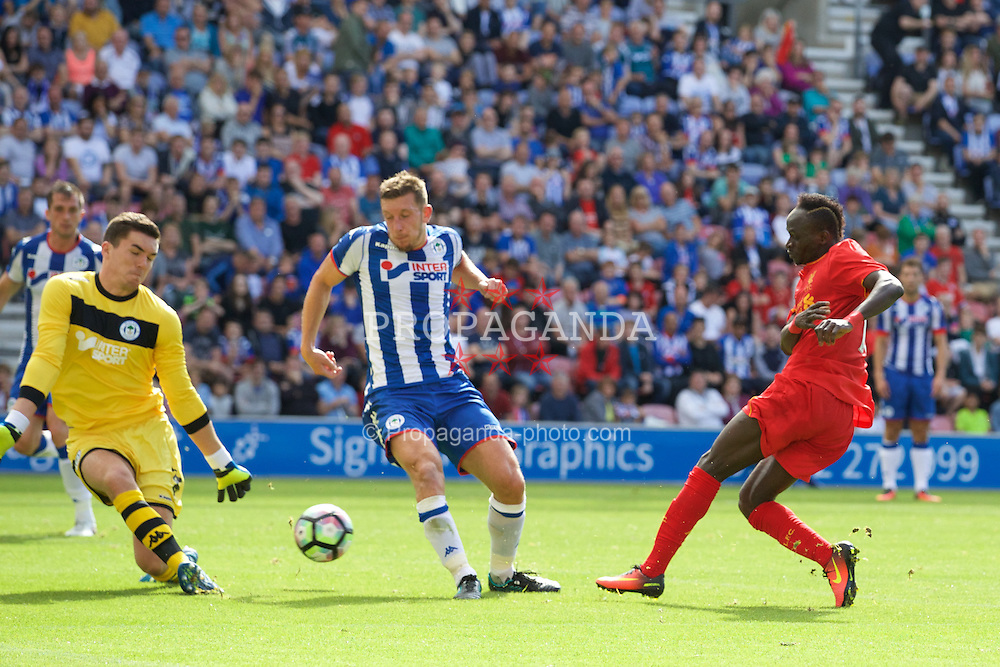 WIGAN, ENGLAND - Sunday, July 17, 2016: Liverpool's Sadio Mane sees his shot saved by Wigan Athletic's goalkeeper Lee Nicholls during a pre-season friendly match at the DW Stadium. (Pic by David Rawcliffe/Propaganda)