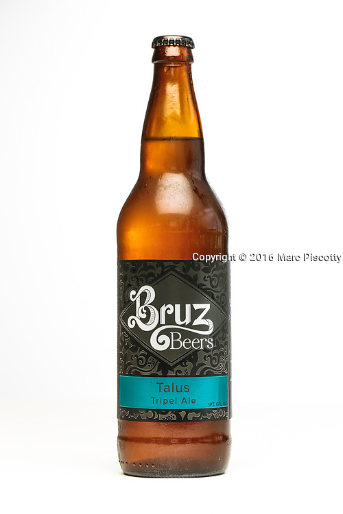 SHOT 7/22/16 2:53:37 PM - Bruz Beers is Denver's artisanal Belgian-style brewery, featuring a full line of traditional and Belgian-inspired brews, hand-crafted in small batches. A bottle of the Talus Tripel Ale. (Photo by Marc Piscotty / © 2016)