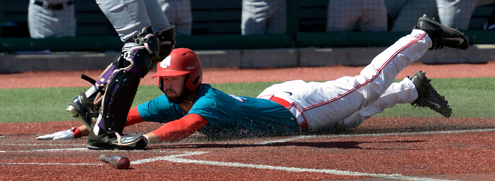 gbs032217z/SPORTS -- UNM's Danny Collier slides in safe at home in the second inning of the game against Grand Canyon University at the Santa Ana Star Field on Wednesday, March 22, 2016. (Greg Sorber/Albuquerque Journal)