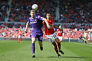 Stoke City defender Nathan Collins (37)  and Middlesbrough forward Ashley Fletcher (18)  contest a loose ball during the EFL Sky Bet Championship match between Middlesbrough and Stoke City at the Riverside Stadium, Middlesbrough, England on 19 April 2019.