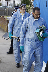 © Licensed to London News Pictures. 14/03/2018. London, UK. Forensics officers arrive at the house of Russian exile Nikolai Glushkov in south west London. Mr Glushkov, a friend of oligarch Boris Berezovsky, and a former deputy director of Russian state airline Aeroflot, died at his home in Monday night. Police continue to investigate.  Photo credit: Peter Macdiarmid/LNP