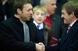 LIVERPOOL, ENGLAND - Sunday, December 13, 2009: xxxx, husband of Liverpool's new solicitor Natalie Wignall, with Kenny Dalglish during the Premiership match at Anfield. (Photo by: David Rawcliffe/Propaganda)