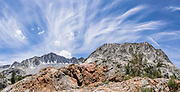 Cirrus clouds streak over Mount Goode (13,085 feet, left) and Hurd Peak (12,237 ft, right). My favorite hike in the Bishop Creek watershed goes from South Lake to Long Lake and Saddlerock Lake, looping back via a steeper, poorly marked route to Ruwau Lake, Chocolate Lakes, and Bull Lake, in John Muir Wilderness, Inyo National Forest, Sierra Nevada, California, USA. The rewarding semi-loop is 9 miles with 2220 feet cumulative gain. An easier walk is 7.2 miles round trip with 1500 feet gain to Saddlerock Lake, out and back via beautiful Long Lake. This panorama was stitched from 2 overlapping photos.