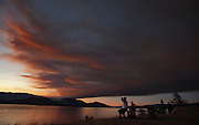 Smoke from a nearby forest fire gathers over Okanagan Lake at sunset in Kelowna, BC.  (2009)