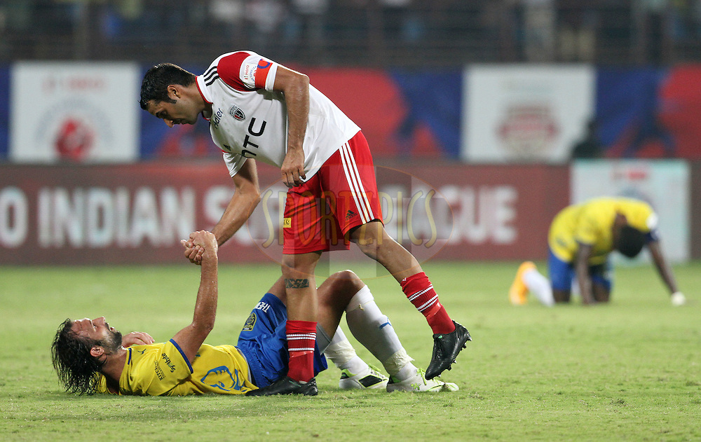 Miguel Garcia of NorthEast United FC and Cedric Hengbart of Kerala Blasters FC shake hands after the match 49 of the Hero Indian Super League between Kerala Blasters FC and North East United FC held at the Jawaharlal Nehru Stadium, Kochi, India on the 4th December 2014.<br /> <br /> Photo by:  Vipin Pawar/ ISL/ SPORTZPICS