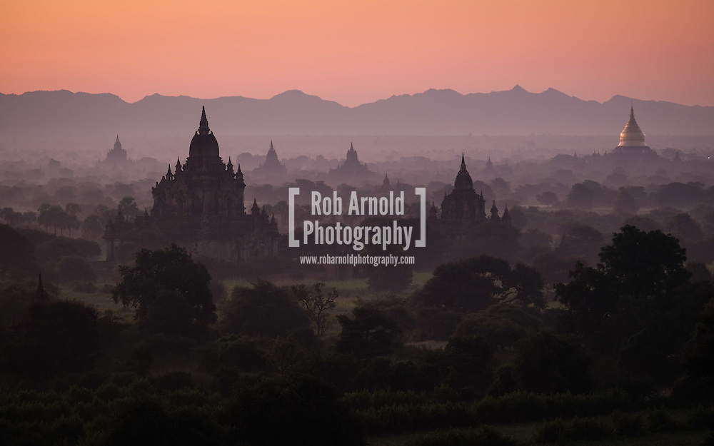 Dawn over the ancient temples scattered through the misty Bagan landscape