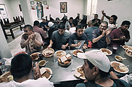 Men prepare to eat during Dinner time while staying at Casa Migrantes in Tijuana, Mexico on Monday, May 1, 2017.  Many people who come to the border are allowed to apply for asylum and are being shooed away by Customs and border protection agents(Photo by Sandy Huffaker/Zuma Press)