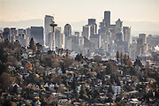 Homes in Seattle's Queen Anne neighborhood with downtown in the distance. (Steve Ringman / The Seattle Times)