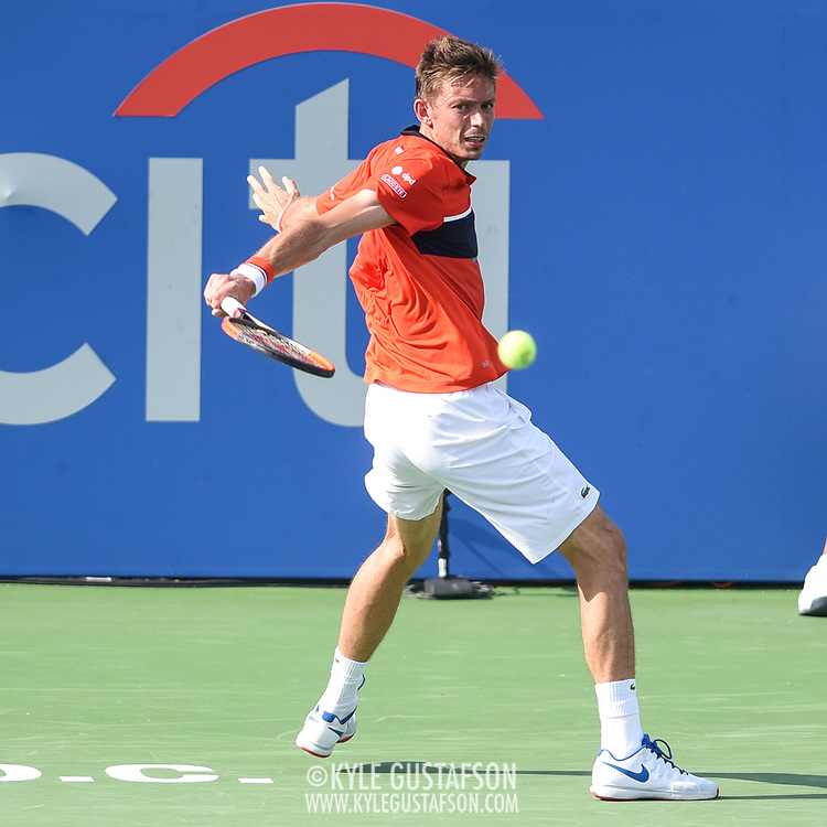 NICOLAS MAHUT hits a slice backhand during his second round match at the Citi Open at the Rock Creek Park Tennis Center in Washington, D.C.