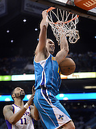 Apr 7, 2013; Phoenix, AZ, USA; New Orleans Hornets forward Lou Amundson (17) dunks the ball against the Phoenix Suns forward Markieff Morris (11) in the second half at US Airways Center. The Hornets defeated the Suns 95-92. Mandatory Credit: Jennifer Stewart-USA TODAY Sports
