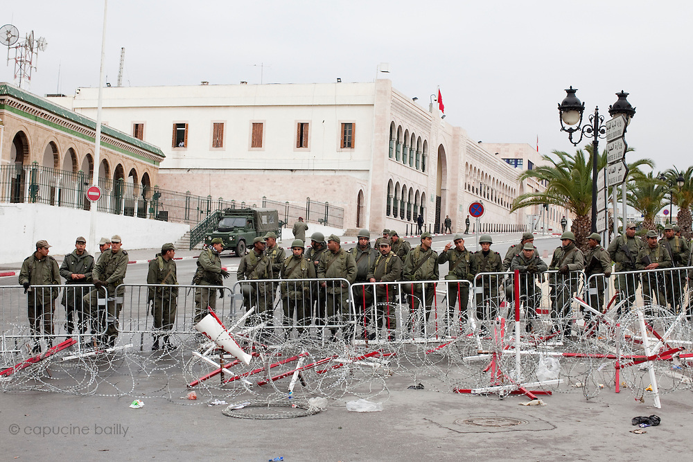 Tunis, Tunisia. January 25th 2011.The army at the entrance of the Kasbah Square where people protest outside the Prime Minister's office (Mohammed Ghannouchi). Protesters demand the removal of members of the ousted president's regime (Zine El Abidine Ben Ali) still in the government.....