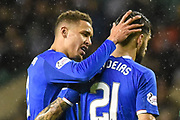 James Tavernier congratulates Daniel Candeias on scoring goal during the Ladbrokes Scottish Premiership match between Hibernian and Rangers at Easter Road, Edinburgh, Scotland on 8 March 2019.