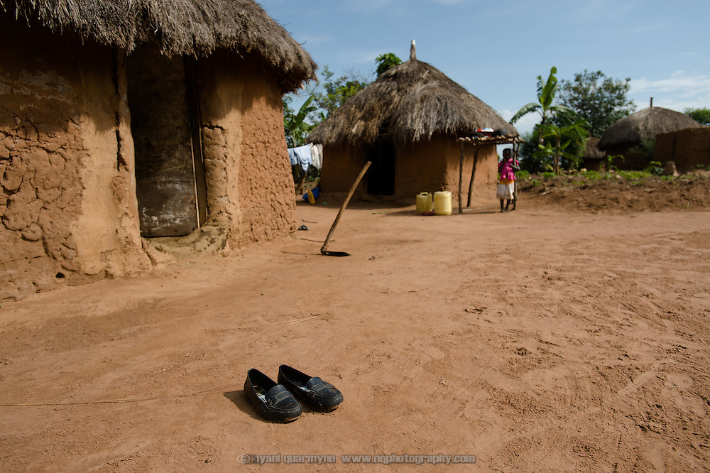 Catherine Apoyo's school shoes are seen in front of a hut at her home near Tororo, Uganda on 2 August 2014.