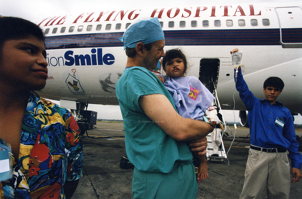 Panama City , February 1999 - Bill Megee, co-founder of &quot;Operation Smile&quot; , with a child who has to have an operation on the Flying hospital.<br /> <br /> Operation Smile is a private, not-for-profit volunteer medical services organization providing reconstructive surgery and related health care to indigent children worldwide.
