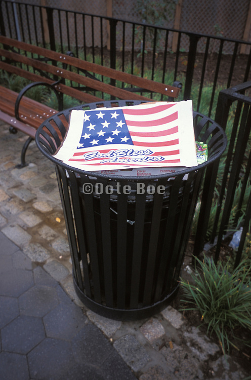 American pizza box thrown in the trash