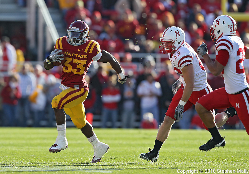 November 06 2010: Iowa State Cyclones running back Alexander Robinson (33) runs away from Nebraska Cornhuskers defensive back Lance Thorell (23) as Nebraska Cornhuskers defensive back Eric Hagg (28) closes in during the first half of the NCAA football game between the Nebraska Cornhuskers and the Iowa State Cyclones at Jack Trice Stadium in Ames, Iowa on Saturday November 6, 2010. Nebraska defeated Iowa State 31-30.