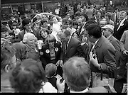 15/05/1982<br /> 05/15/1982<br /> 15 May 1982<br /> An Taoiseach, Mr Charles Haughey, canvasing with Fianna Fail bye-election candidate Eileen Lemass in Dublin West. An Taoiseach and Eileen Lemass meet the people, possibly at the Superquinn Centre in Blanchardstown. Appears that the Taoiseach has just given a young First Holy Communion recipient a few pounds, or that the young man is making a donation to Fianna Fail.