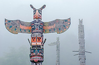 Namgis Burial totem poles in the fog at Alert Bay in British Columbia, Canada.