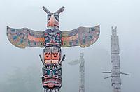 Namgis Burial totem poles in the fog at Alert Bay in British Columbia, Canada.