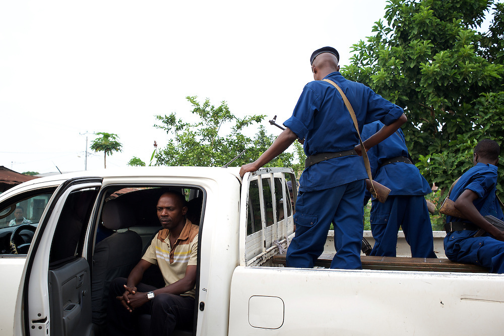 Augustin Burikukiye, a doctor and local leader of the opposition party FNL, sits in a National Police truck as he is arrested after a police raid to his house in Cibitoke neighbourhood, Bujumbura. The police commander in charged of the operation claimed they found suspicious material during a search for weapons and grenades. Accusation denied by the accused.
