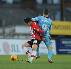 Exeter City's Tom Nichols jostles for the ball with Tranmere Rovers's Max Power - Photo mandatory by-line: Dougie Allward/JMP - Mobile: 07966 386802 - 31/01/2015 - SPORT - Football - Exeter - St James Park - Exeter City v Tranmere Rovers - Sky Bet League Two