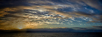 Panorama of the sky and clouds over the Pacific Ocean at sunrise from the deck of the MV World Odyssey. Semester at Sea, 2016 Spring Semester Voyage. Day 3 of 102. Composite of three mages taken with a Leica T camera and 23 mm f/2 lens (ISO 100, 23 mm, f/14, 1/250 sec).