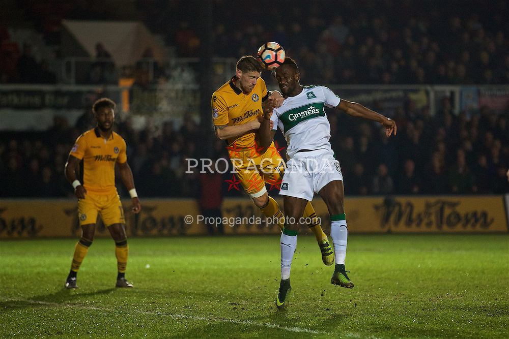 NEWPORT, WALES - Wednesday, December 21, 2016: Plymouth Argyle's Jordan Slew in action against Newport County's Scot Bennett during the FA Cup 2nd Round Replay match at Rodney Parade. (Pic by David Rawcliffe/Propaganda)