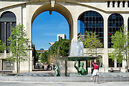 Photographing a fountain in the Place de Thessalie, in the Antigone District designed in a grand neo-classical style by the architect Ricardo Bofill from Catalonia, Spain. In this area of Montpellier classical motifs such as pediments, entablatures and pilasters are blown up to a gigantic scale. The district is located between the old centre of Montpellier and the river Lez.