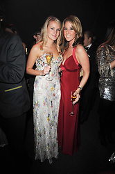 Left to right, LEONORA TAEE and heiress FAWN JAMES at the Collars & Coats Gala Ball celebrating 150 years of Battersea Dogs & Cats Home held at Battersea Power Station, London on 25th November 2010.