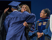 Houston ISD board president Rhonda Skillern-Jones congratulates graduates during the first ever graduation for Mickey Leland College Preparatory Academy, May 27, 2015.