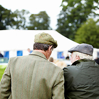 A photograph of two farmers having a conversation at Cockermouth Show, an agricultural show in Cockermouth, Cumbria, England