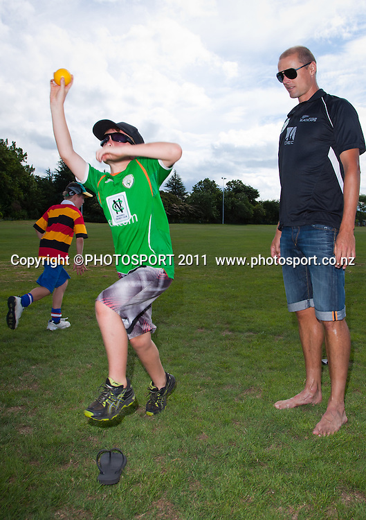 Chris Martin runs a bowling skills session with Connor Rondel, 10, during the NCC Super Camp for Primary School players, an initiative by The National Bank to connect with the grass roots of cricket, hosted by Hamilton Star University Cricket Club, Waikato University, Hamilton, New Zealand, Wednesday 5 January 2011. Photo: Stephen Barker/PHOTOSPORT