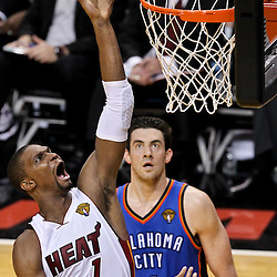 Jun 21, 2012; Miami, FL, USA; Miami Heat power forward Chris Bosh (1) shoots over Oklahoma City Thunder point guard Derek Fisher (37) during the second quarter in game five in the 2012 NBA Finals at the American Airlines Arena. Mandatory Credit: Derick E. Hingle-US PRESSWIRE