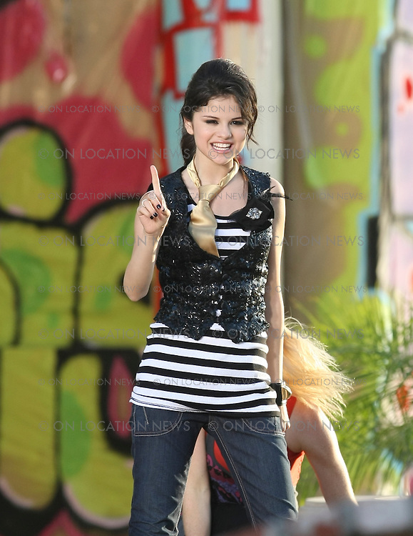 """LOS ANGELES, CALIFORNIA - Saturday 19th JULY 2008 ***EXCLUSIVE*** Selena Gomez films a music video for her song """"Tell Me Something I don't Know"""". The song is for the soundtrack for the movie """"Another Cinderella Story"""" in which Gomez will star. Selena Gomez also known as Miley Cyrus 2.0 had a great time dancing and singing during the video shoot. Selena had many friends and family that was on set with her during the shoot to give her support. There were also about 50 teenage fans that worked as extras in one of the performance scenes for the video. Gomez was very gracious and nice to all her fans that showed up to the shoot. After filming Selena signed autographs and posed for photos for every fan that asked. Photograph: On Location News. Sales: Eric Ford 1/818-613-3955 info@OnLocationNews.com.."""