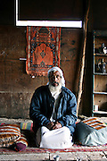 Abed El Minam, 52, is sitting in his home inside the unrecognised Bedouin village of Tarrabin el Sana, close to Beer Sheva, the capital of the Negev, a large deserted area in the south of Israel. The village, bordering the wealthy Israeli settlement of Omer, is surrounded by barbed wire and bound to be demolished as it is deemed illegal by the authorities, willing to further expand Omer's borders. Numbering around 200.000 in Israel, the Bedouins constitute the native ethnic group of these areas, they farm, grow wheat, olives and live in complete self sufficiency. Many of them were in these lands long before the Israeli State was created and their traditional lifestyle is now threatened by subtle Governmental policies. The seven Bedouin towns already built are all between the 10 more impoverished towns in Israel..