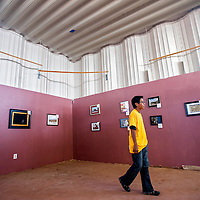 090513       Cable Hoover<br /> <br /> Cody Tsosie browses a photography exhibit at the Nizhoni Arts Market at the Navajo Nation Fair in Window Rock Thursday.