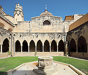 Cloister of the Cathedral of St Mary, designed by Benito Dalguayre in Catalan Gothic style and begun 1347 on the site of a Romanesque cathedral, consecrated 1447 and completed in 1757, Tortosa, Catalonia, Spain. The cloister is on the South side of the cathedral, with a Gothic arched colonnade and central fountain. Picture by Manuel Cohen