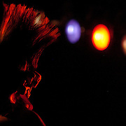 """""""Pebbles"""", a backup dancer for the punk/ska/rockabilly band The Horrorpops, looks out over the crowd during a show in Johnson City, N.Y., at the Magic City Music Hall on Sept. 16.  The Horrorpops opened for the Boston-based Irish-punk band, the Dropkick Murphys.  Photo by Kris Wilson."""