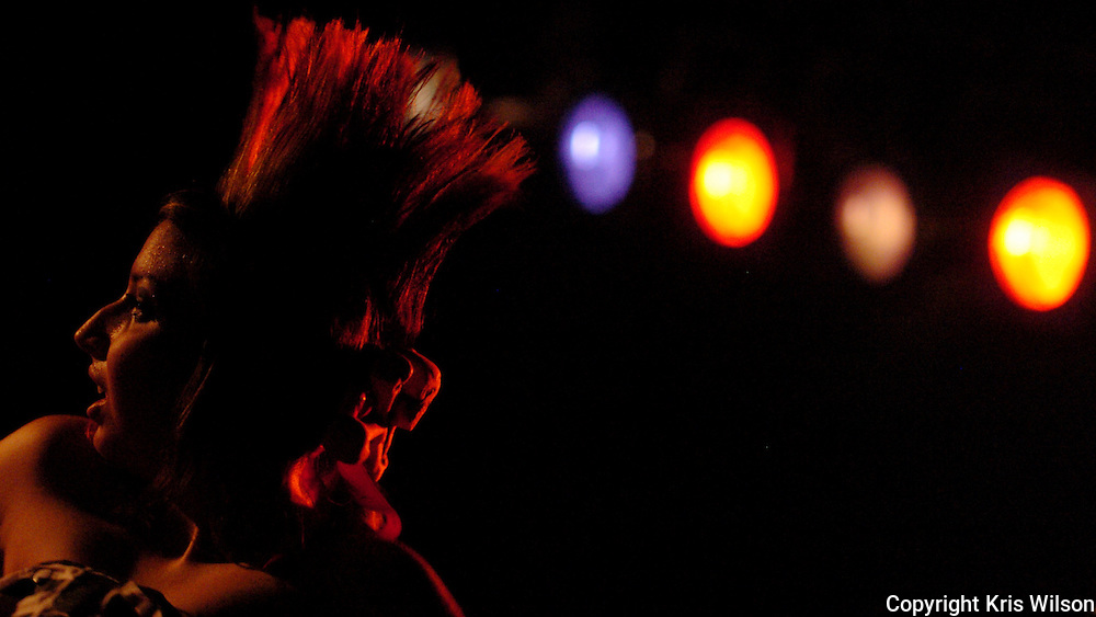 """Pebbles"", a backup dancer for the punk/ska/rockabilly band The Horrorpops, looks out over the crowd during a show in Johnson City, N.Y., at the Magic City Music Hall on Sept. 16.  The Horrorpops opened for the Boston-based Irish-punk band, the Dropkick Murphys.  Photo by Kris Wilson."