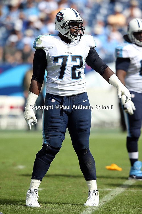 Tennessee Titans tackle Michael Oher (72) waves his arm during the NFL week 6 regular season football game against the Jacksonville Jaguars on Sunday, Oct. 12, 2014 in Nashville, Tenn. The Titans won the game 16-14. ©Paul Anthony Spinelli
