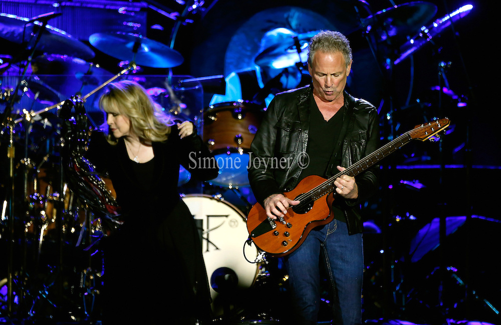 (L-R) Stevie Nicks and Lindsey Buckingham of Fleetwood Mac  perform live on stage at 02 Arena on September 24, 2013 in London, England.  (Photo by Simone Joyner)