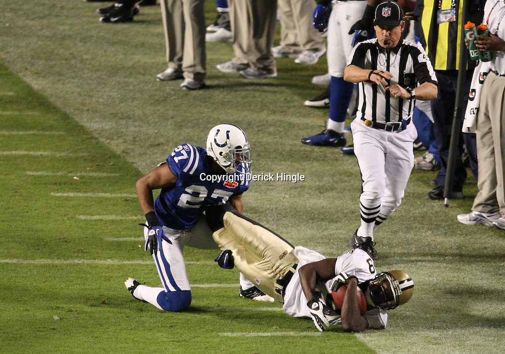 2010 February 07: New Orleans Saints wide receiver Devery Henderson (19) is tackled after a catch by Indianapolis Colts cornerback Jacob Lacey (27)during a 31-17 win by the New Orleans Saints over the Indianapolis Colts in Super Bowl XLIV at Sun Life Stadium in Miami Gardens, Florida.