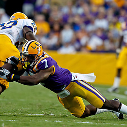 October 16, 2010; Baton Rouge, LA, USA; LSU Tigers cornerback Patrick Peterson (7) tackles McNeese State Cowboys running back Andre Anderson (22) during the first half at Tiger Stadium.  Mandatory Credit: Derick E. Hingle