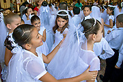 Girls all dressed up for First Holy Communion in Grecia, Costa Rica church.