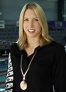 Hannah McLean with her medal from the Commonwealth Games at the 2006 New Zealand Youth and Open Swimming Championships at QEII Leisure Centre, Christchurch on Friday 14 April 2006. Photo: Simon Fergusson/PHOTOSPORT