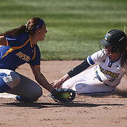 Hofstra University Infielder Lacey Clark (5) tags Delaware utility player Mattie Nuccio (6) at second base for the out during a Colonial Athletic Association regular season softball game between Delaware and Hofstra Saturday, April 16, 2016, at Delaware softball stadium in Newark, Delaware.