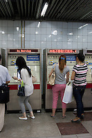people buy tickets from automatic machine in shanghai