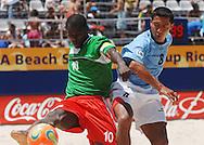 Football-FIFA Beach Soccer World Cup 2006 - Group C-CAM_URU - Etienne Ngiadjoe-CAM- controls the ball in front of Miguel-URU. - Rio de Janeiro - Brazil 06/11/2006<br />Mandatory credit: FIFA/ Marco Antonio Rezende.